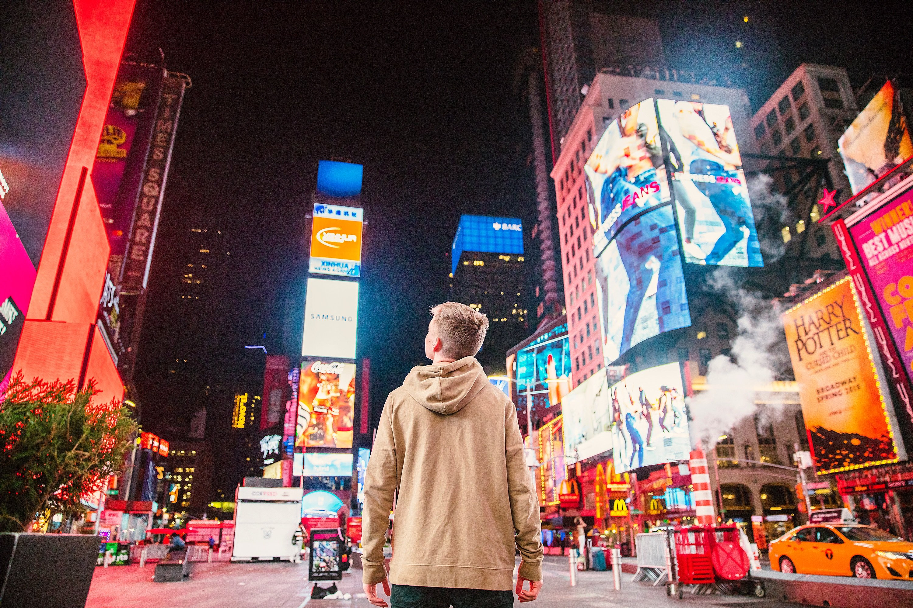 Man standing in Times Square