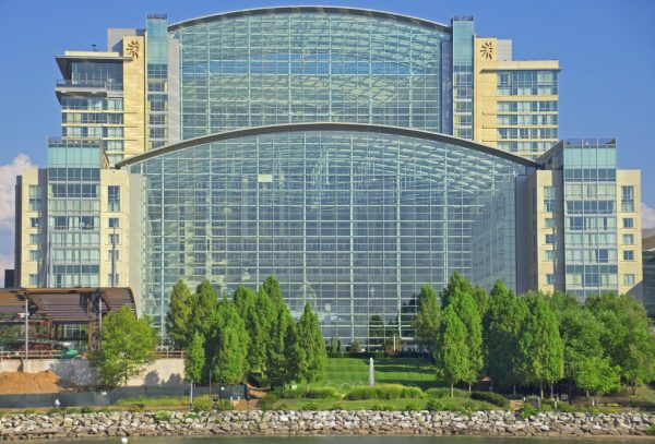 Exterior of Gaylord Convention Center showing wall of windows in bright sunshine